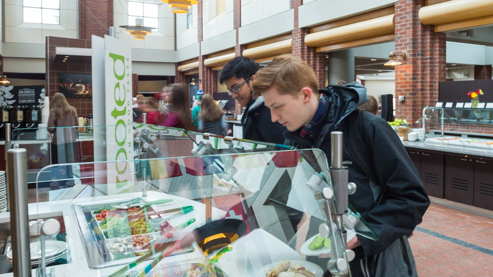 Students get food at the Frank Dining Hall salad station