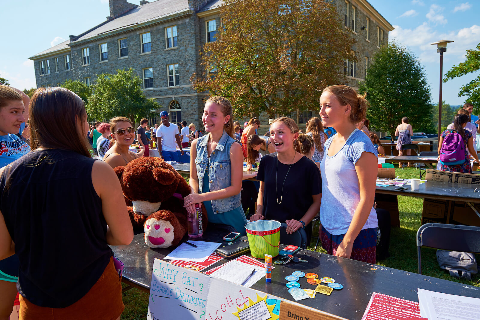 Three leaders of a Colgate club recruit members at the student involvement fair