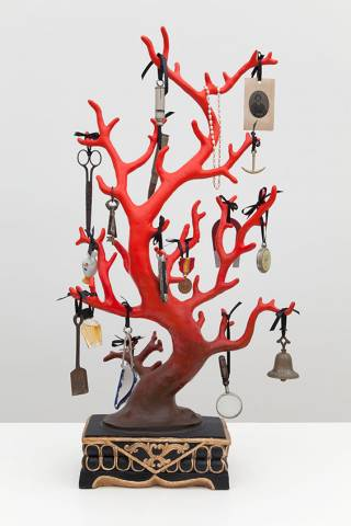 Piece of coral used as a rack to hang jewelry and household objects