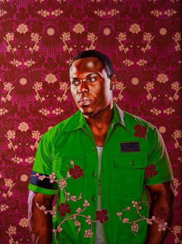 Portrait of black man in front of paisley background