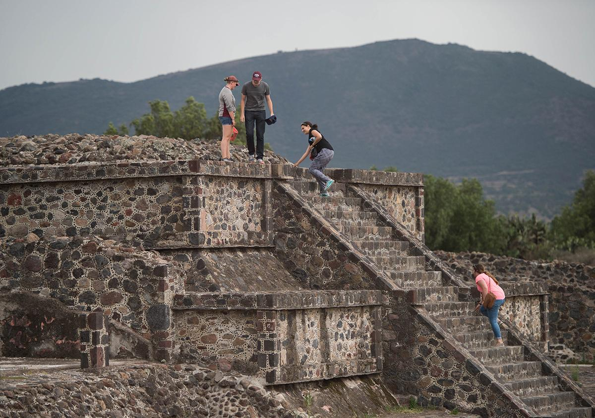 Colgate students climb a stepped pyramid at the ancient city of Teotihuacán