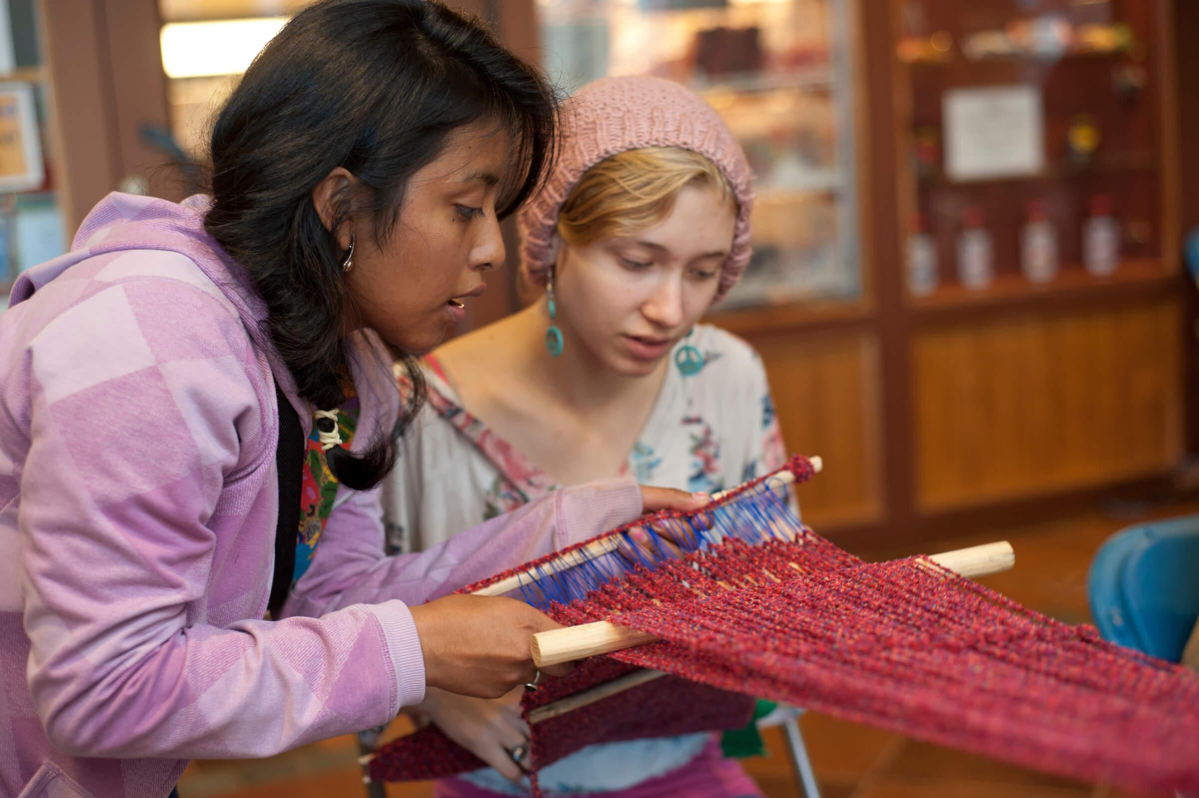 Students participate in a weaving demonstration during Colgate's annual Native American Festival.