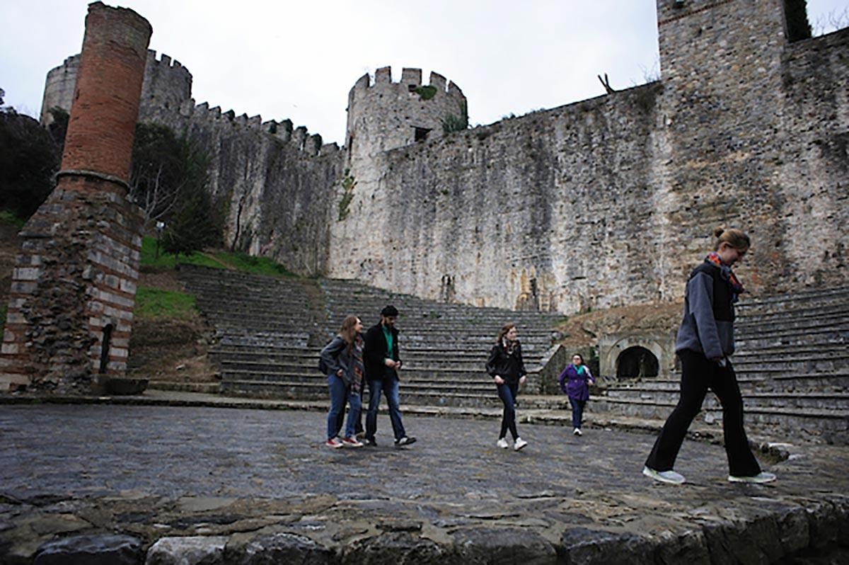 Students traveling in Istanbul tour Rumelian Castle, sometimes referred to as Rumeli Fortress.