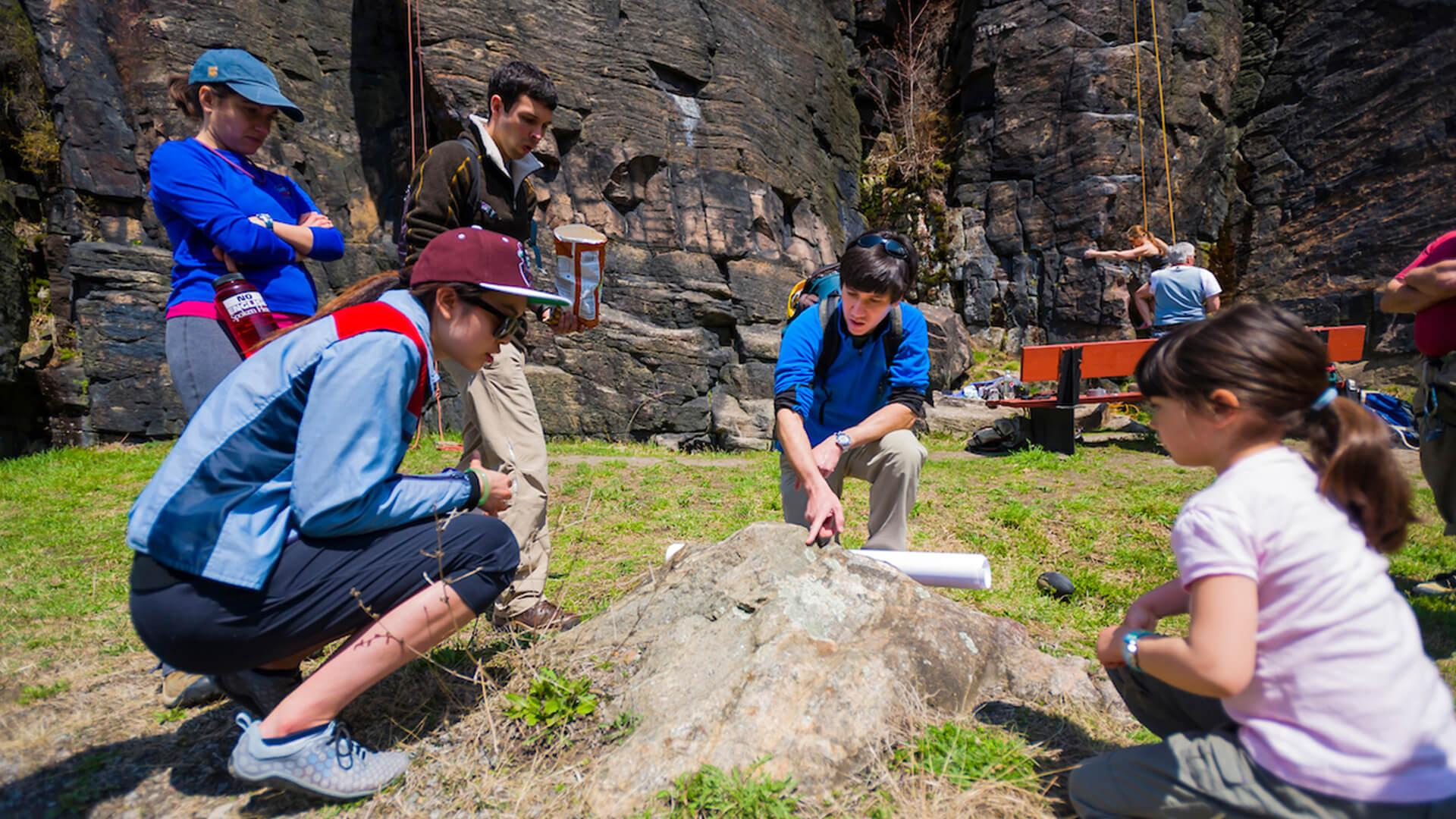 Students and faculty members spend an afternoon lab exploring the geology of Moss Island in Little Falls, N.Y., with geology professor Martin Wong.
