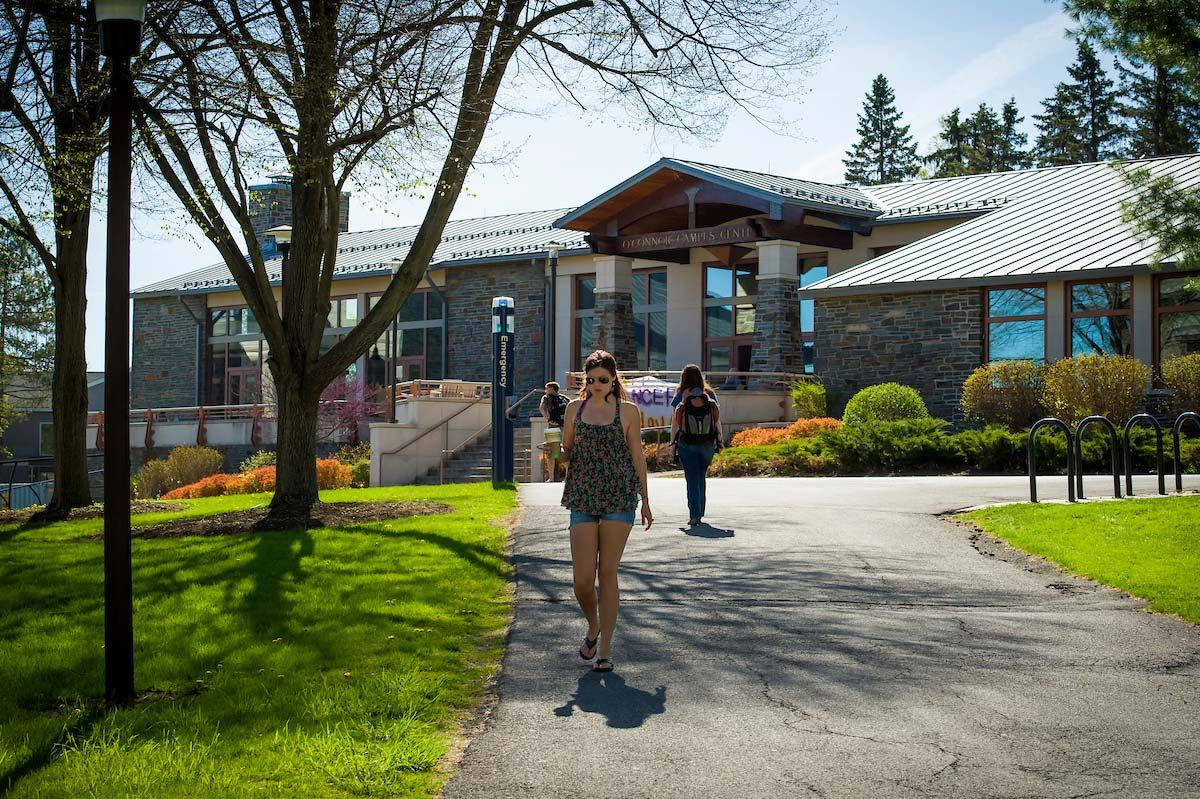 Colgate students walking in front of the O'Connor Campus Center.