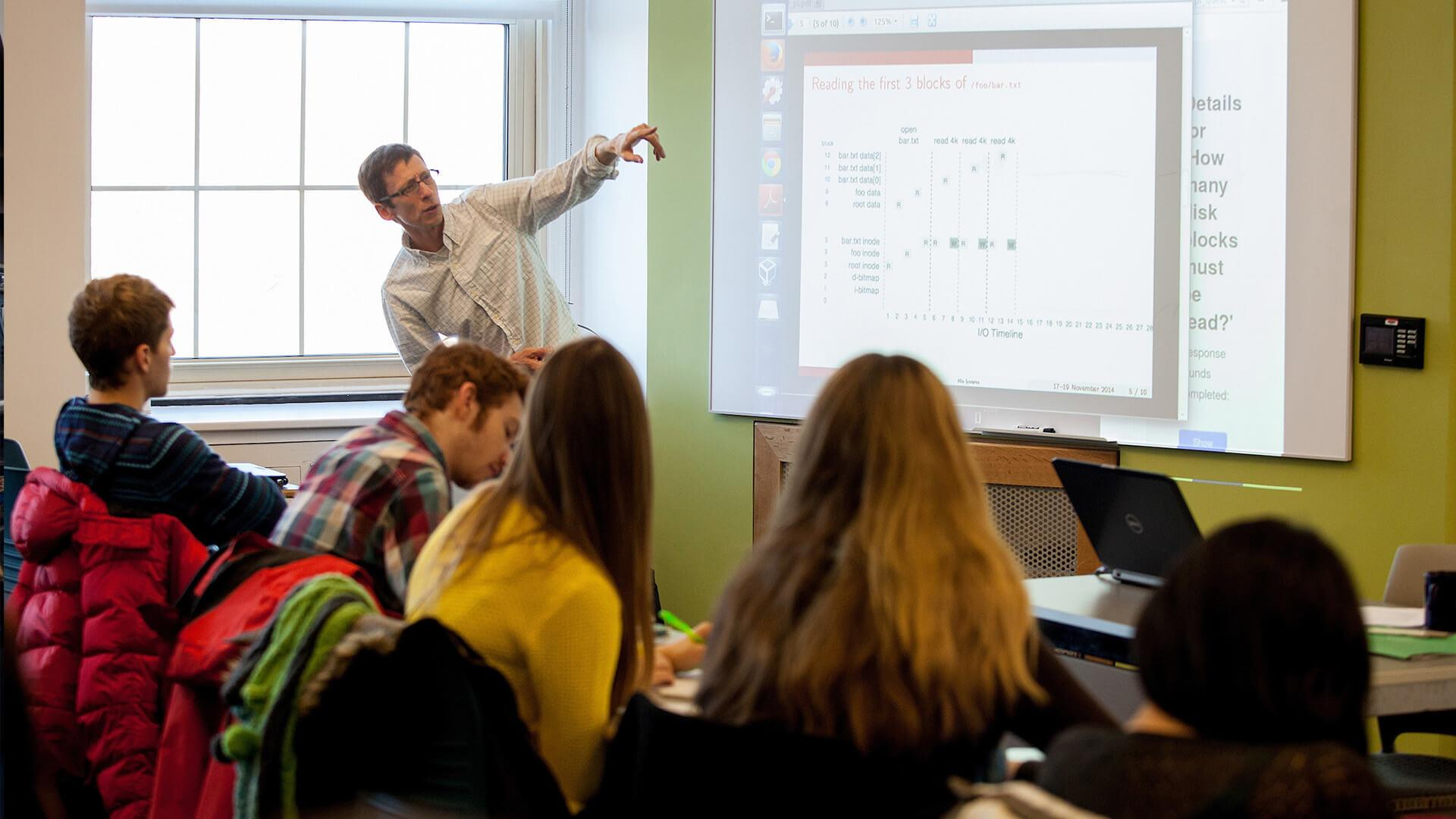 Professor Joel Sommers instructs a classroom of Colgate students.