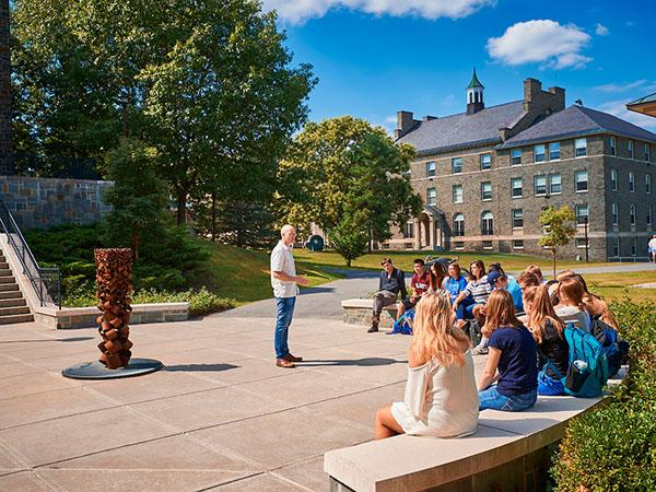"Professor Peter Klepeis teaches a course on ""The Geography of Happiness"" to first-year students on a sunny afternoon outside the Ho Science Center."
