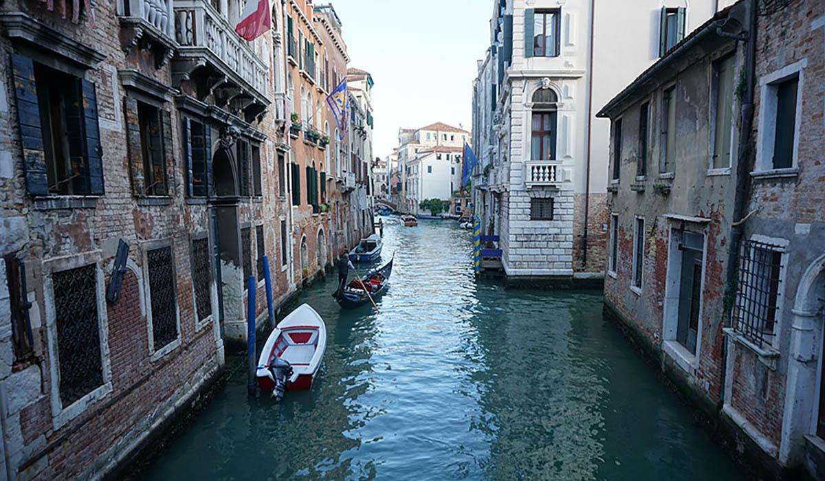 A canal running between buildings in Venice, Italy.