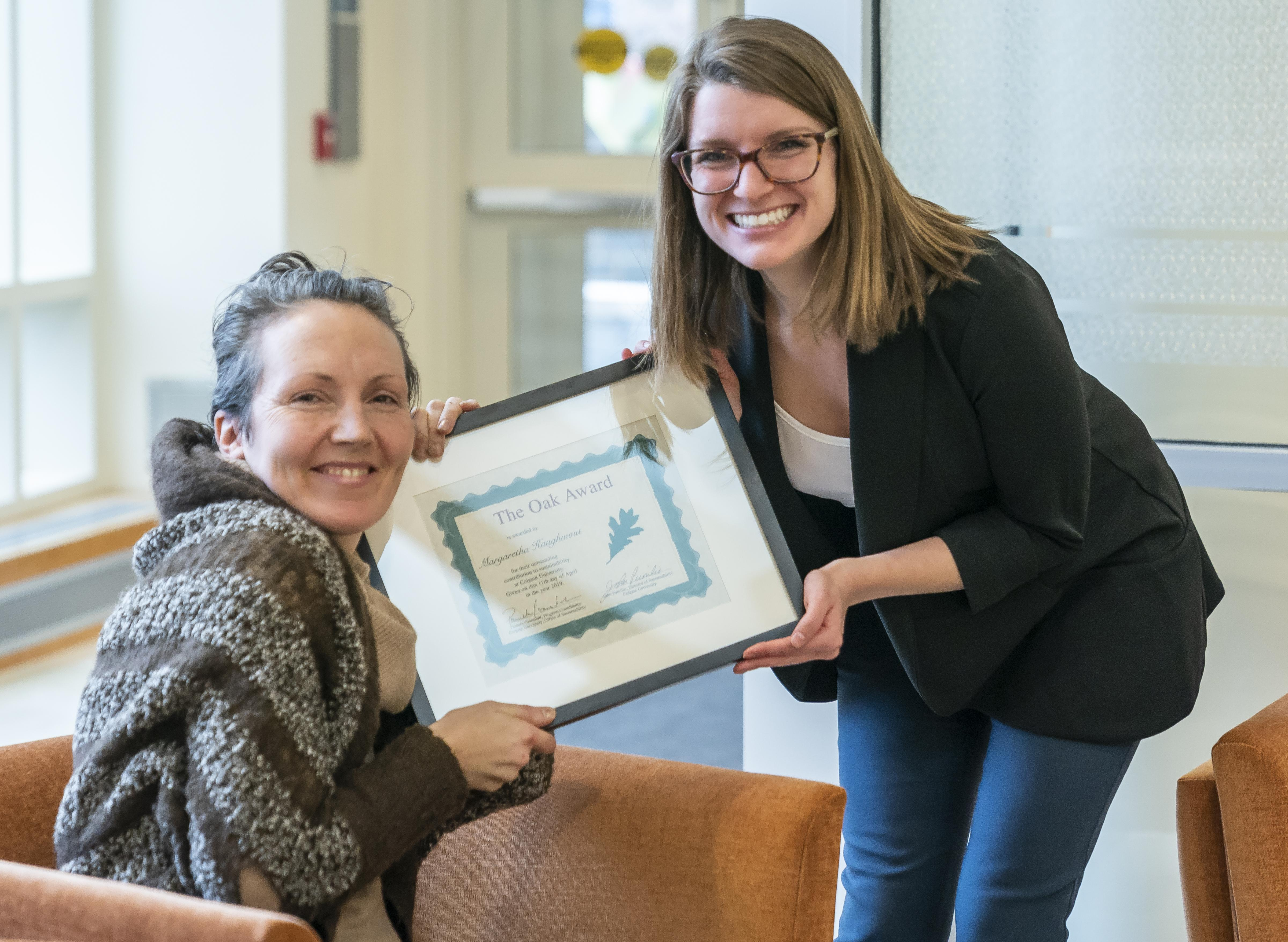 Pamela Gramlich presents an award to Professor Margaretha Haughwout at the Green Summit