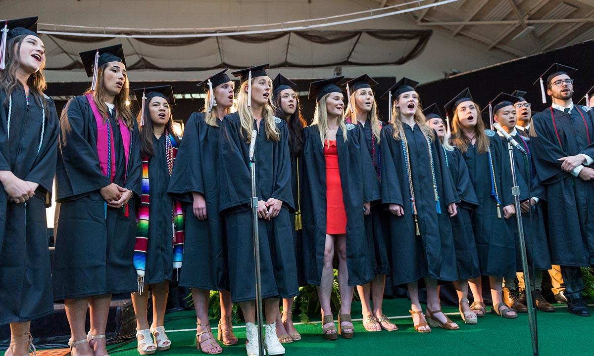 Students sing at commencement