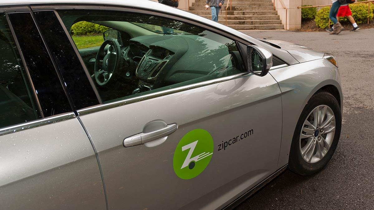 A vehicle with the Zipcar logo on the side