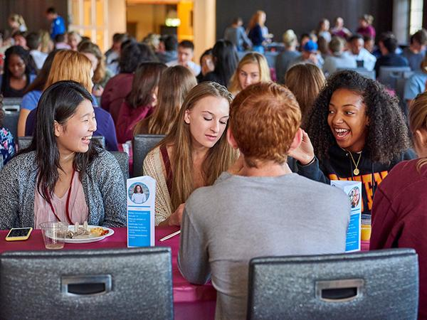 Students laugh and chat over brunch