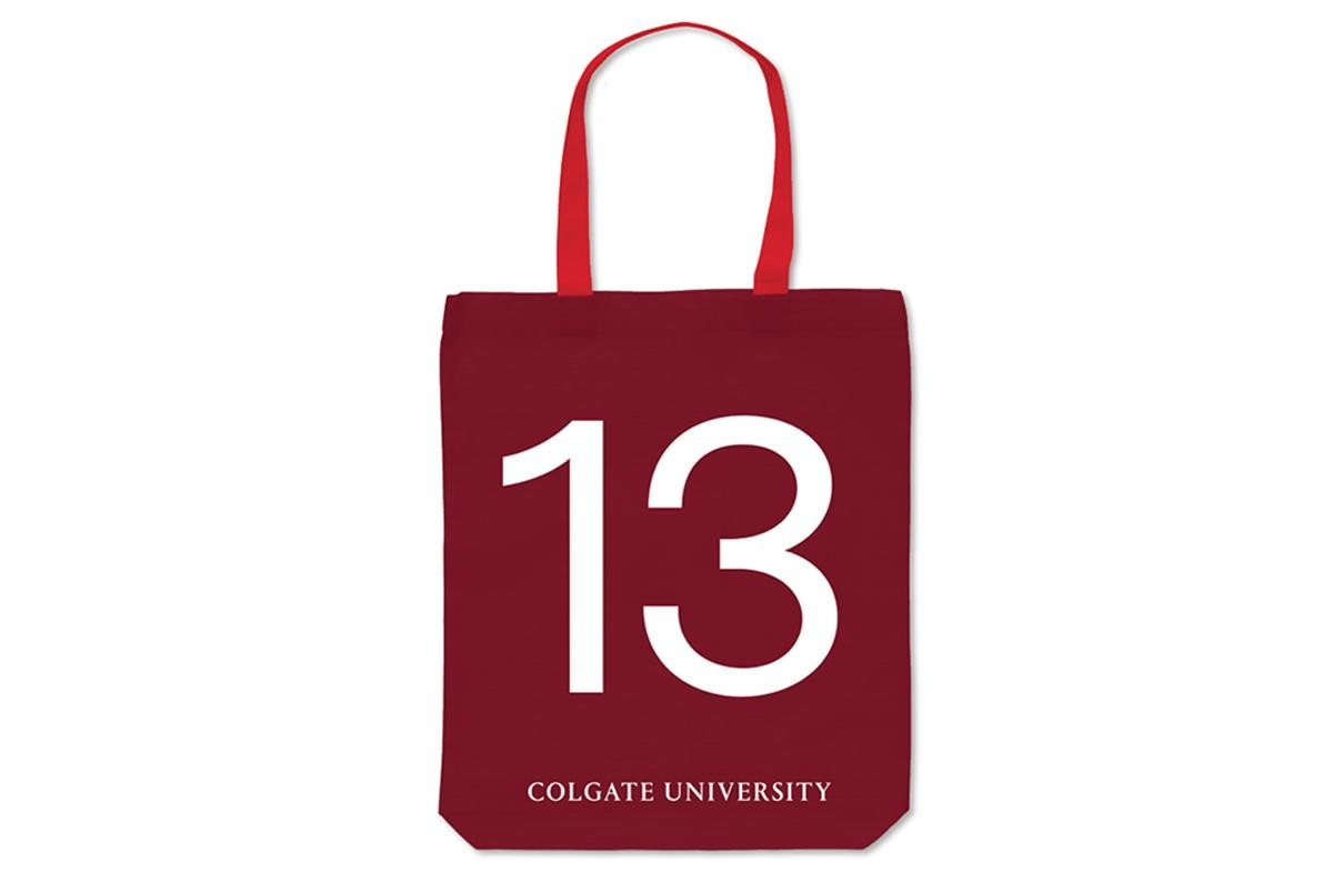 Maroon tote bag with a red handle