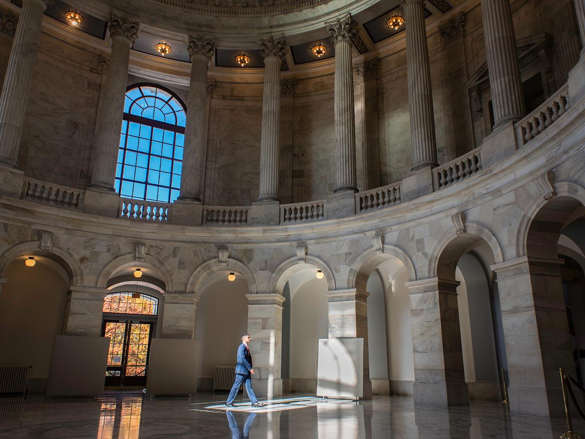 Franco Brunet strides across the Rotunda in the Russell Building.
