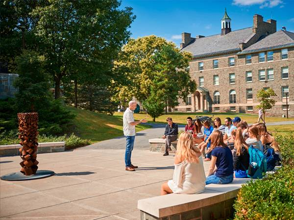 "Peter Klepeis teaches an FSEM course on ""The Geography of Happiness"" to first-year students on a sunny afternoon outside the Ho Science Center."