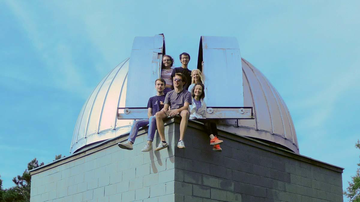 Summer astronomy researchers atop the roof of the observatory