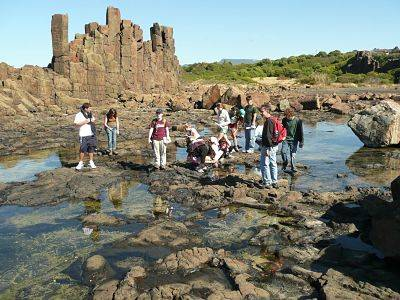 Study group exploring a volcanic landscape south of Wollongong at Bombo, New South Wales