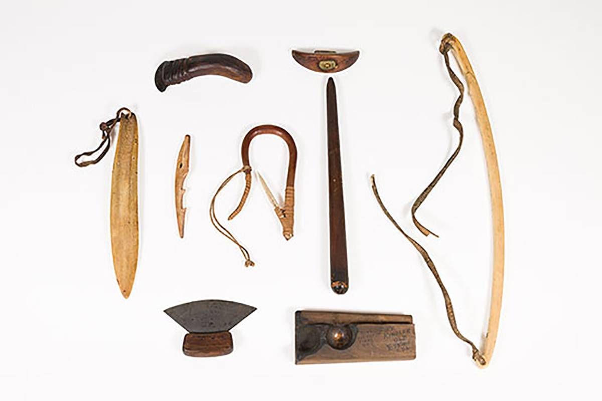Collection of Inuit tools on white background