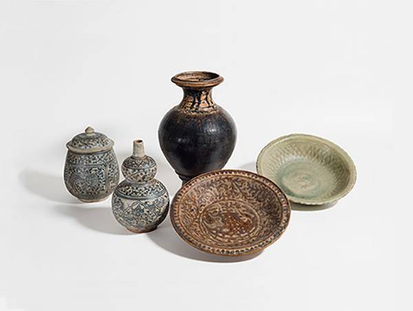 Intricate Thai pottery works on white background