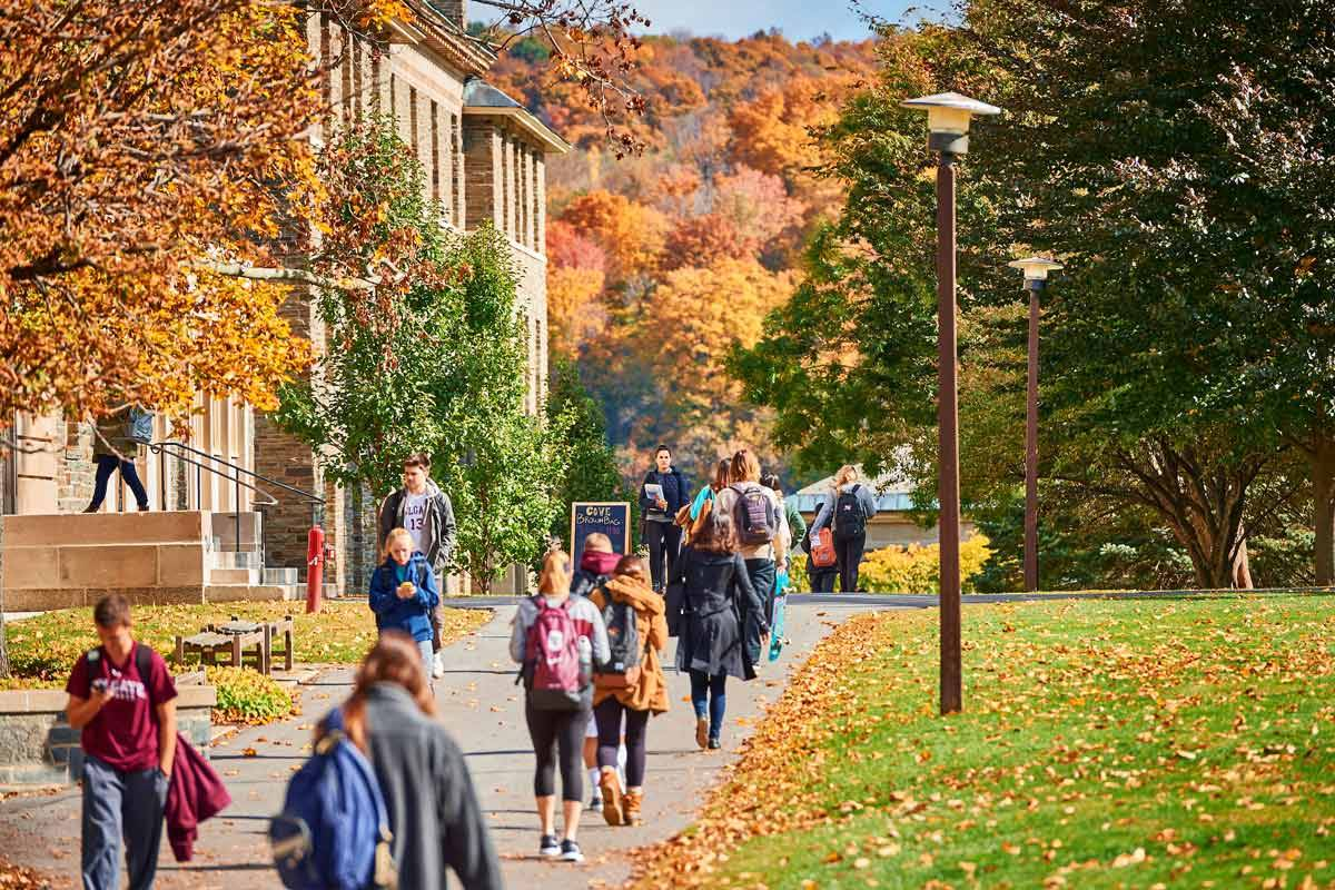 Students walk to class on the academic quad on a beautiful autumn day.