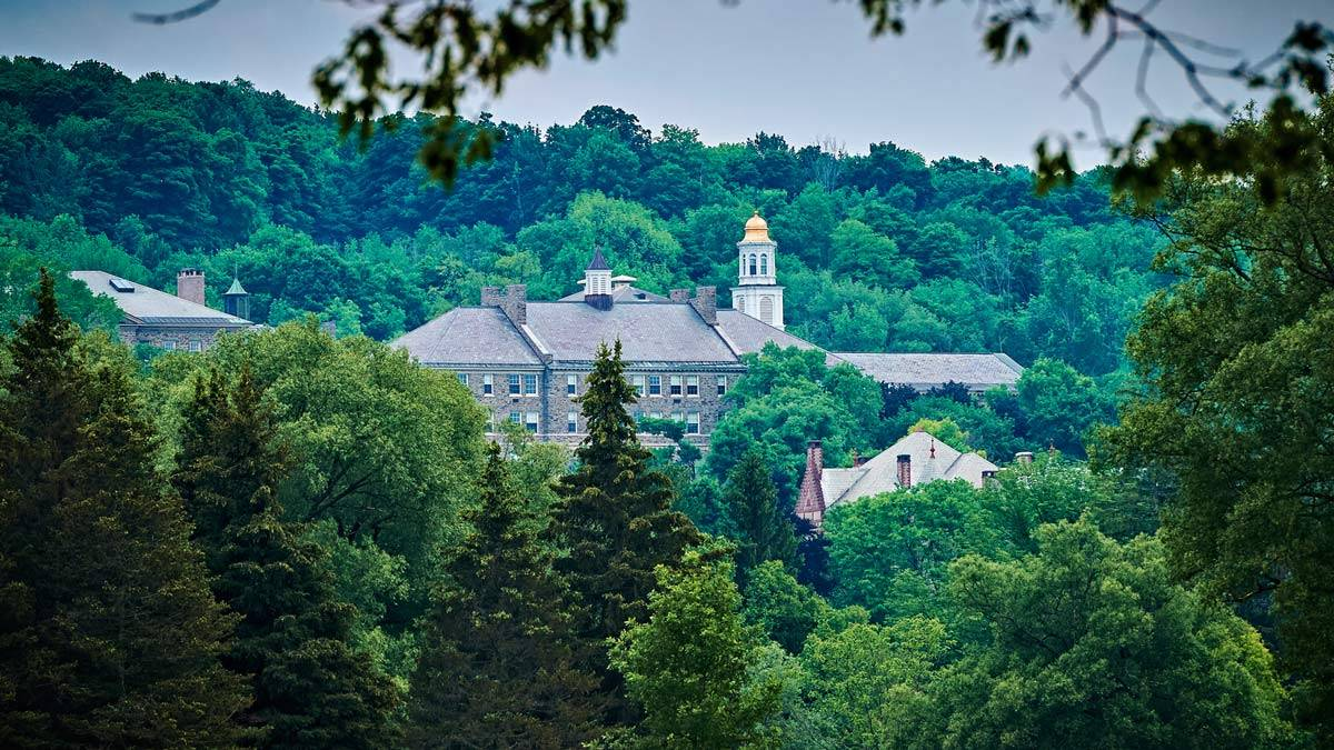 Colgate University through the trees.