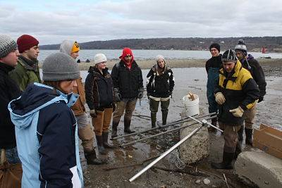 GEOG 401 Senior Seminar collecting a sediment core on the south end of Cayuga Lake, NY