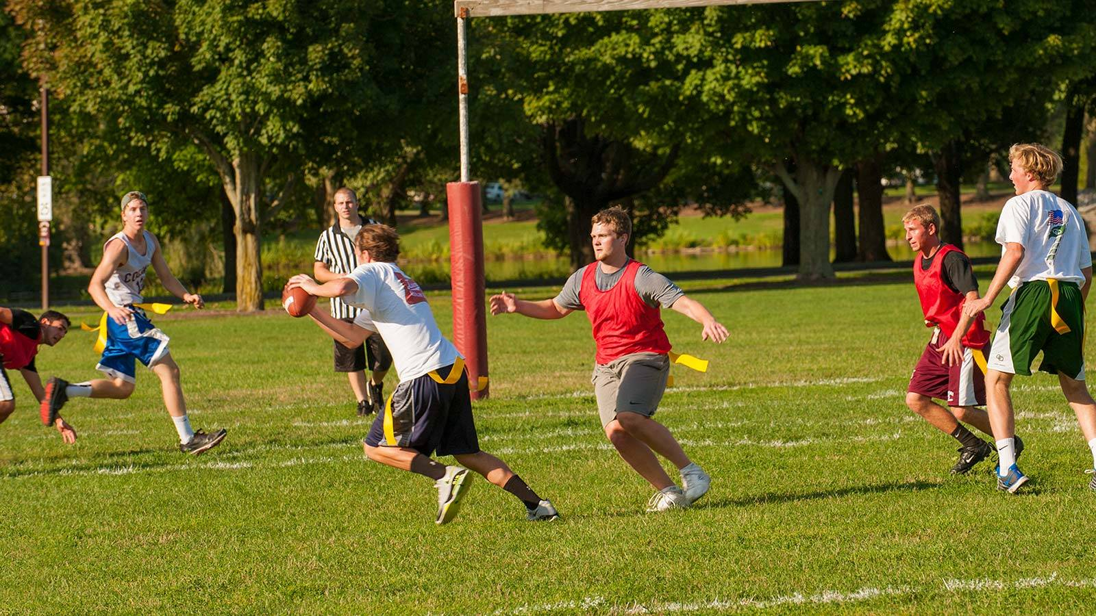 A student official watches a play unfold in intramural flag football