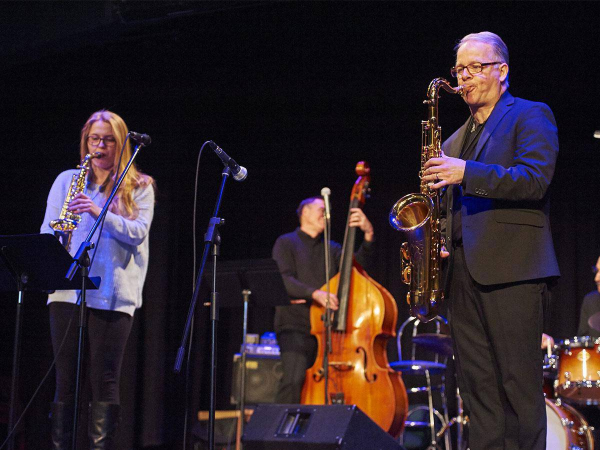 Musicians play jazz on stage at the Palace Theater