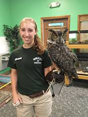 Sarah Sampson '19 with an owl perched on her arm