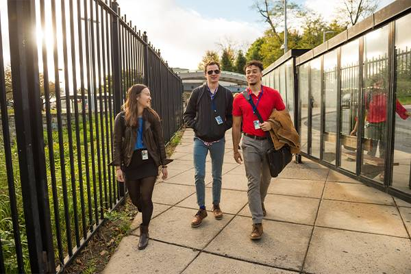 From left, Colgate students Nicole Lue '18, A.J. Ward '18, and Christopher Higham '18, enter the National Institute of Health in Washington D.C., Oct. 24, 2016