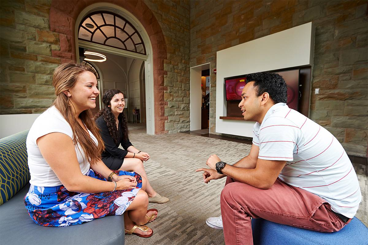 Students talking to each other in the admission lobby