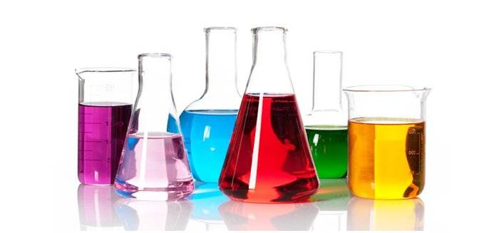 Assorted beakers filled with a variety of colored liquids.