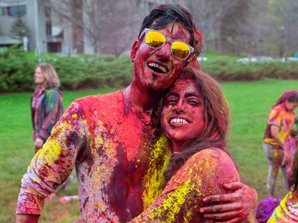 Colgate students participate in the annual Holi Celebration on Whitnall Field.