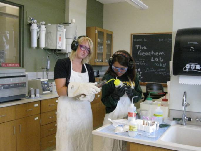 Students preparing samples in the geochemistry lab