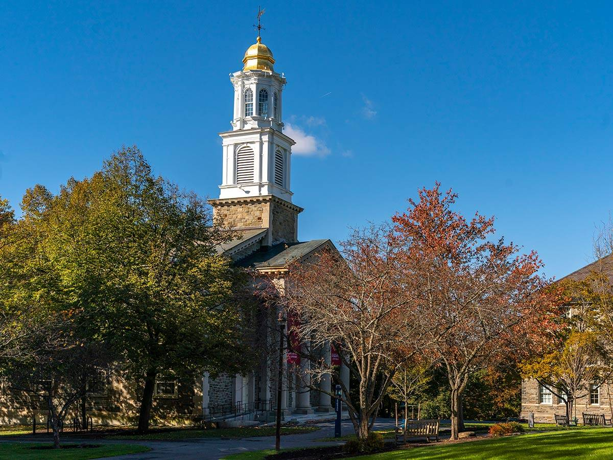 A view of Memorial Chapel on the Academic Quad during early autumn