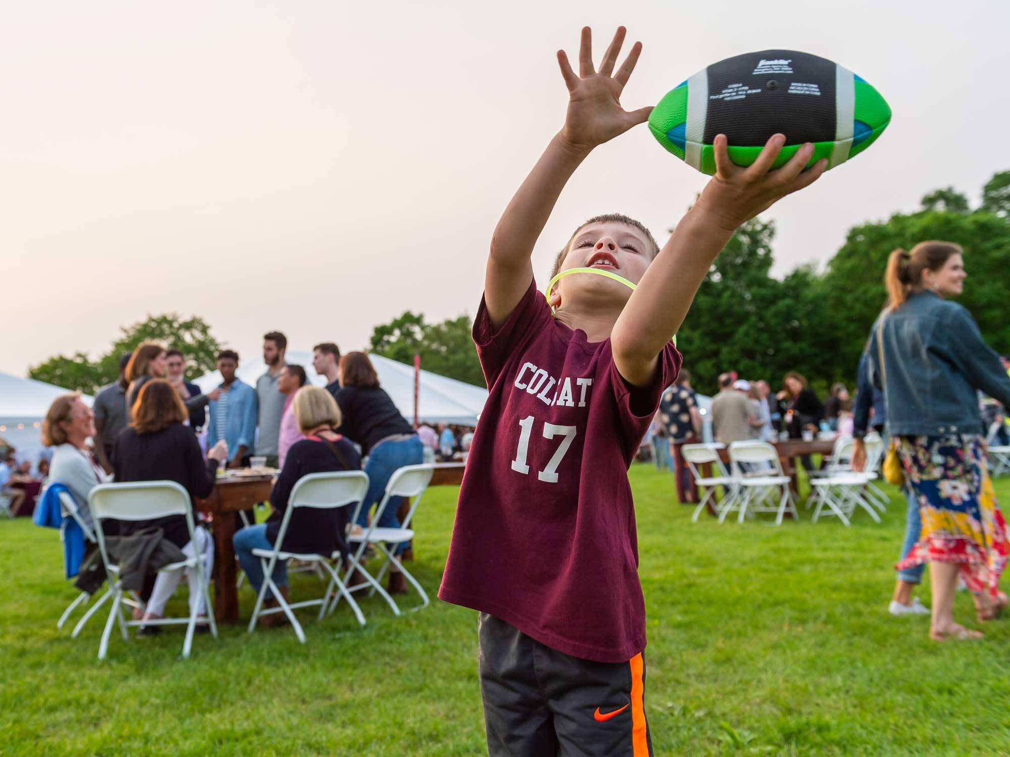 Child catches ball during Reunion picnic