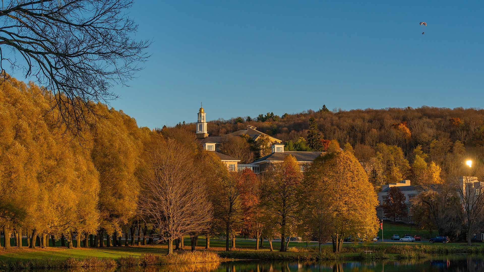 A scenic view of the campus over Taylor Lake with the Memorial Chapel cupola in the background.