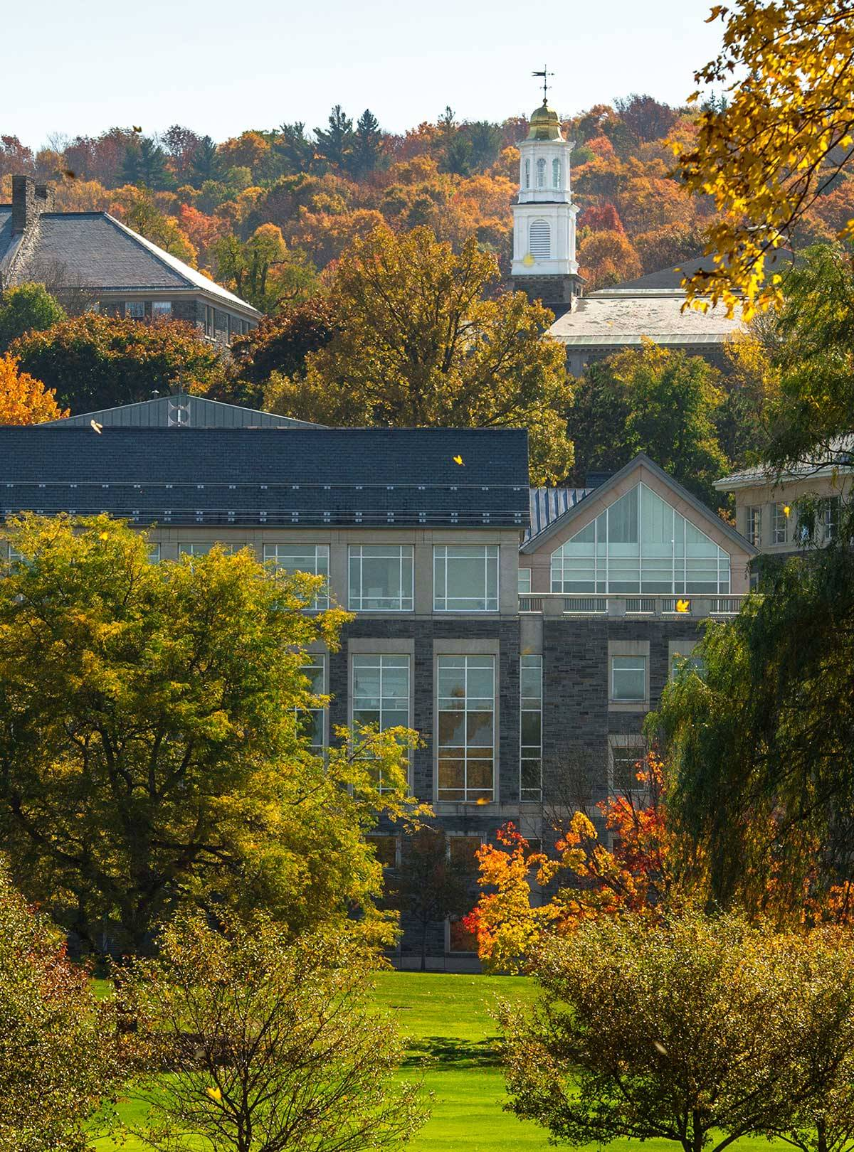 Memorial Chapel visible over Case library amidst fall foliage