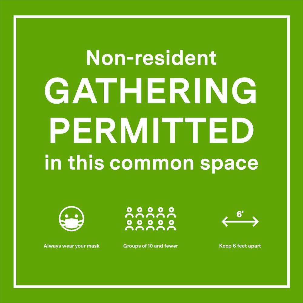Sign showing that gathering is permitted with physical distancing and face coverings