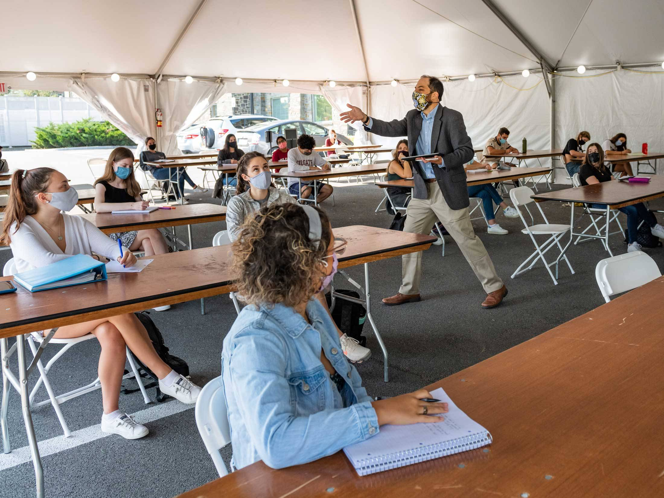 Students take class in tent