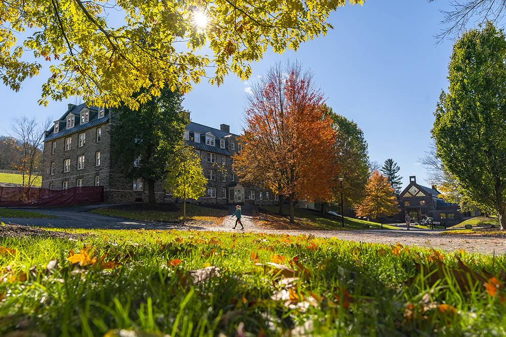 Andrews Hall on a sunny day amidst fall foliage