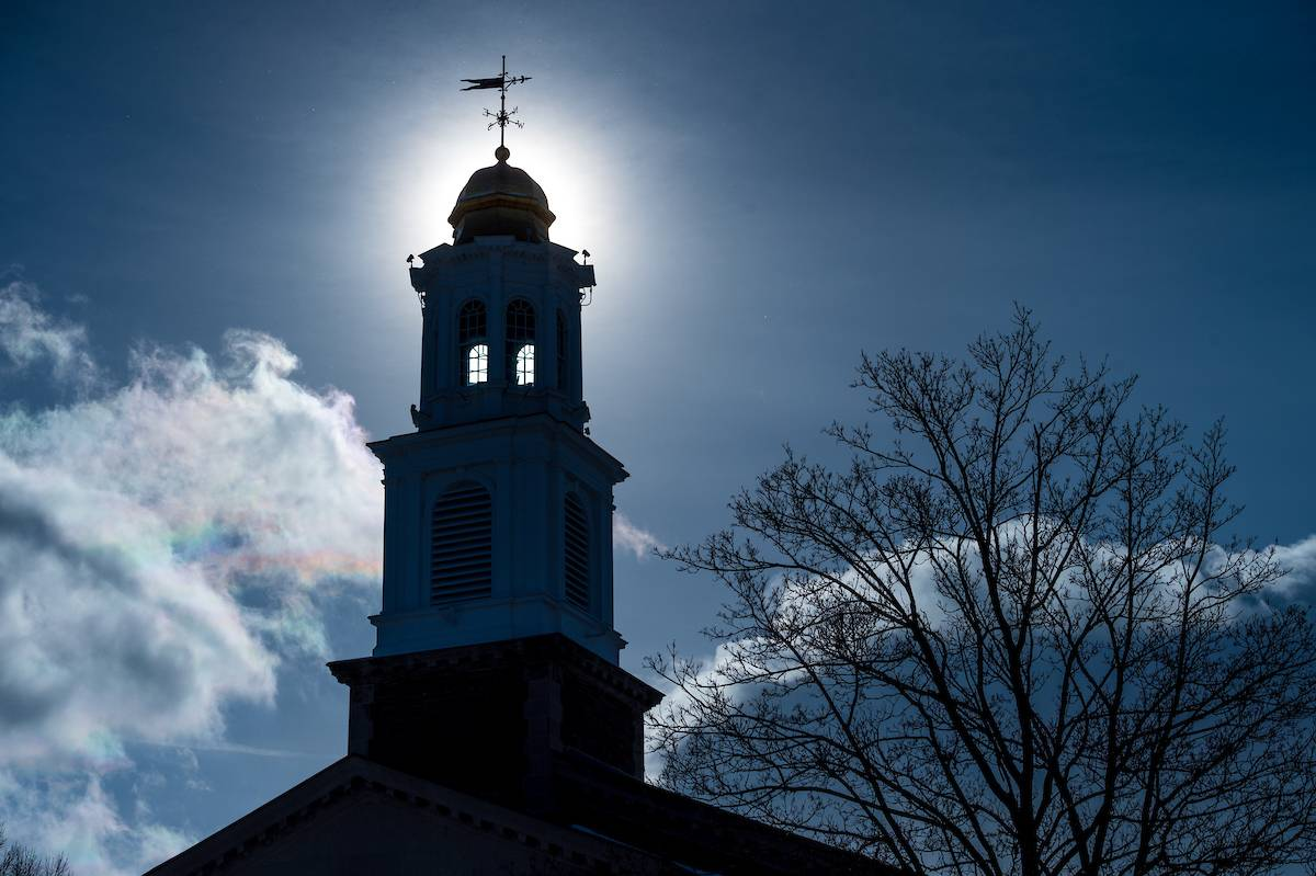 Sun behind Colgate chapel tower
