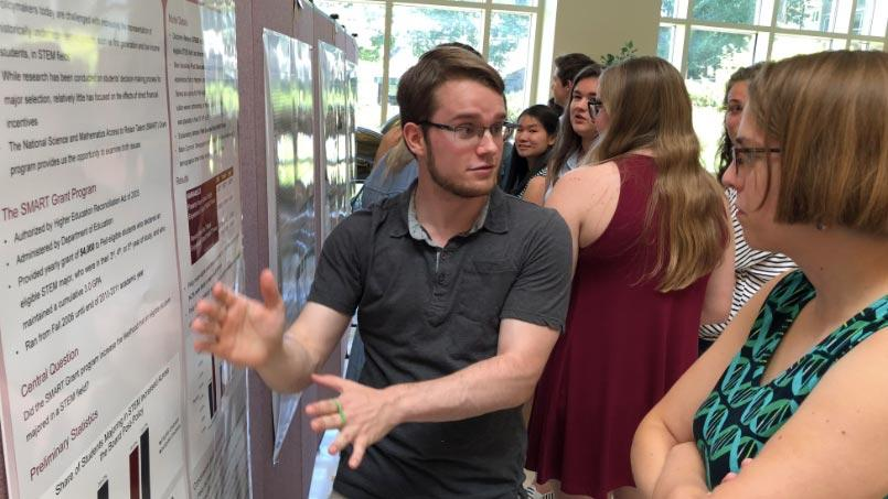 Jake Scott presents an academic poster