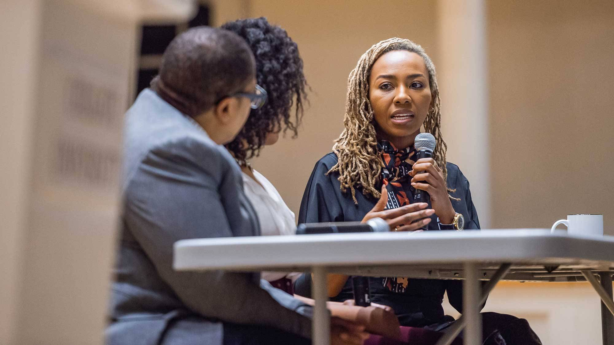 Opal Tometi speaks from Colgate University stage