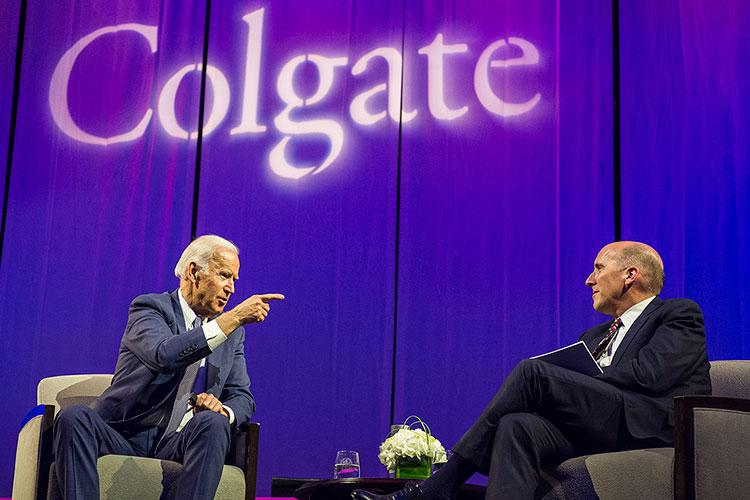 Former Vice President Joe Biden points his finger while chatting with Colgate President Brian W. Casey