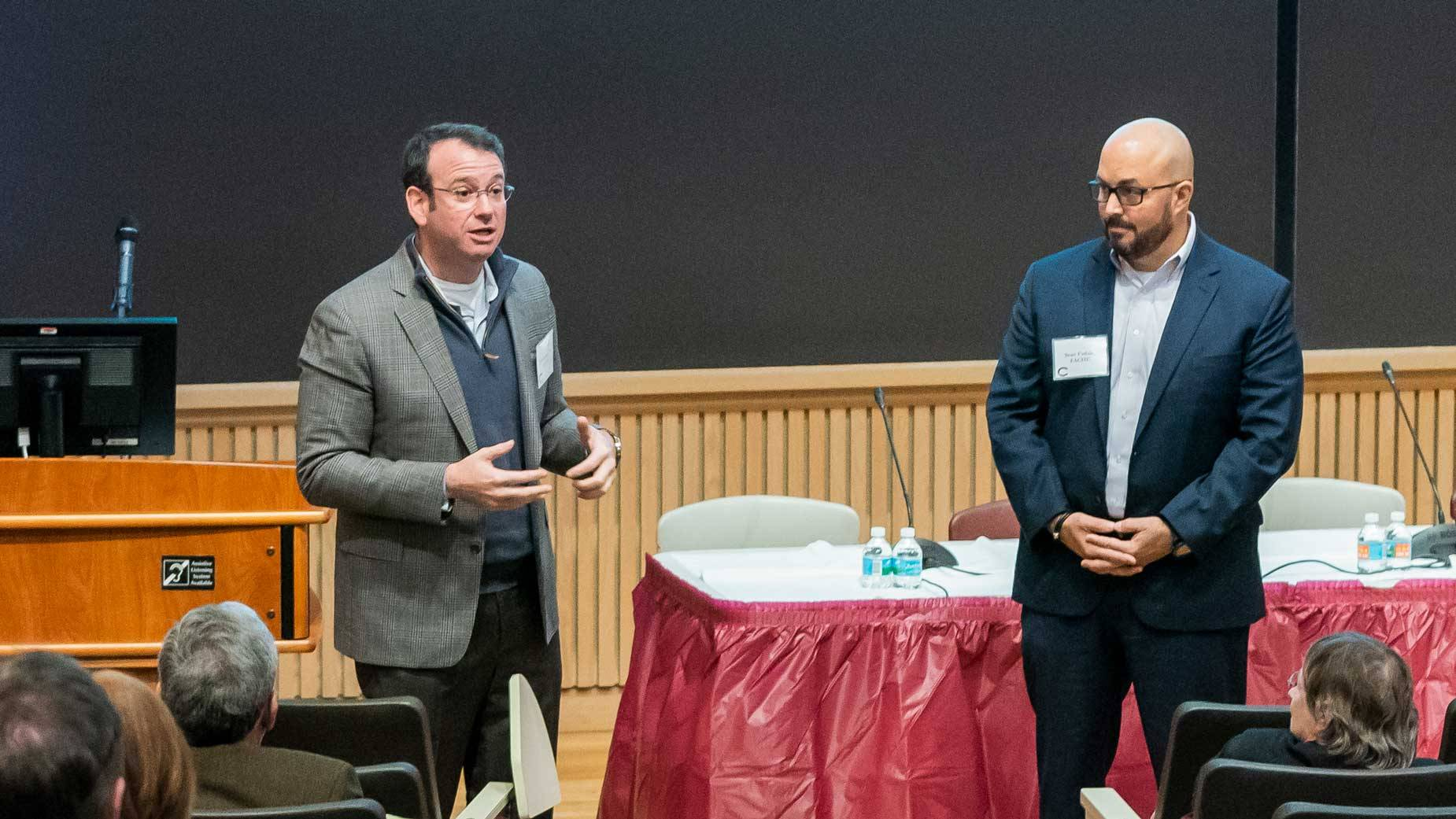 Jon Sendach '98 and Sean Fadale address members of the Colgate community. (Photo by Mark DiOrio)