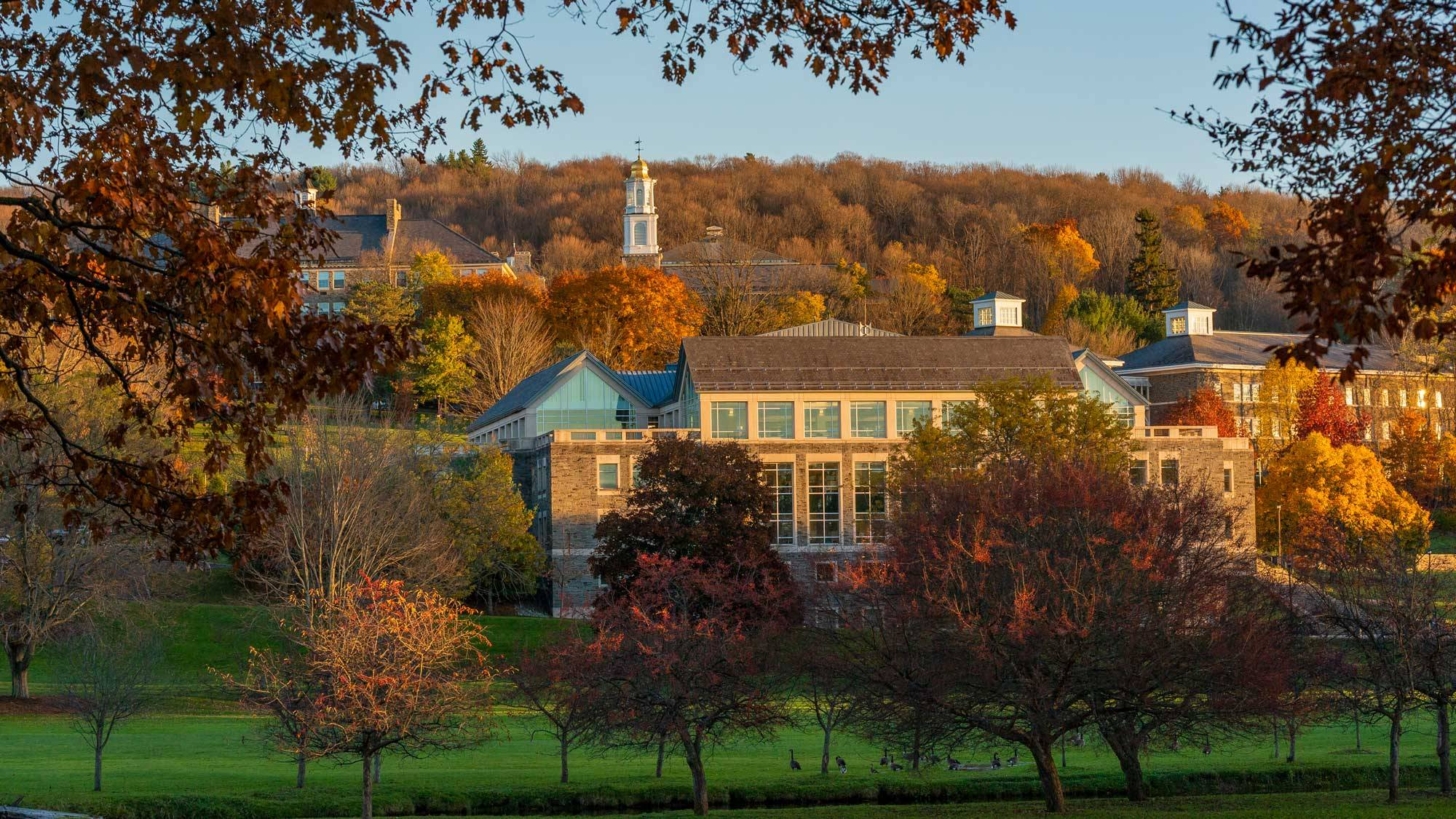 campus buildings with autumn backdrop
