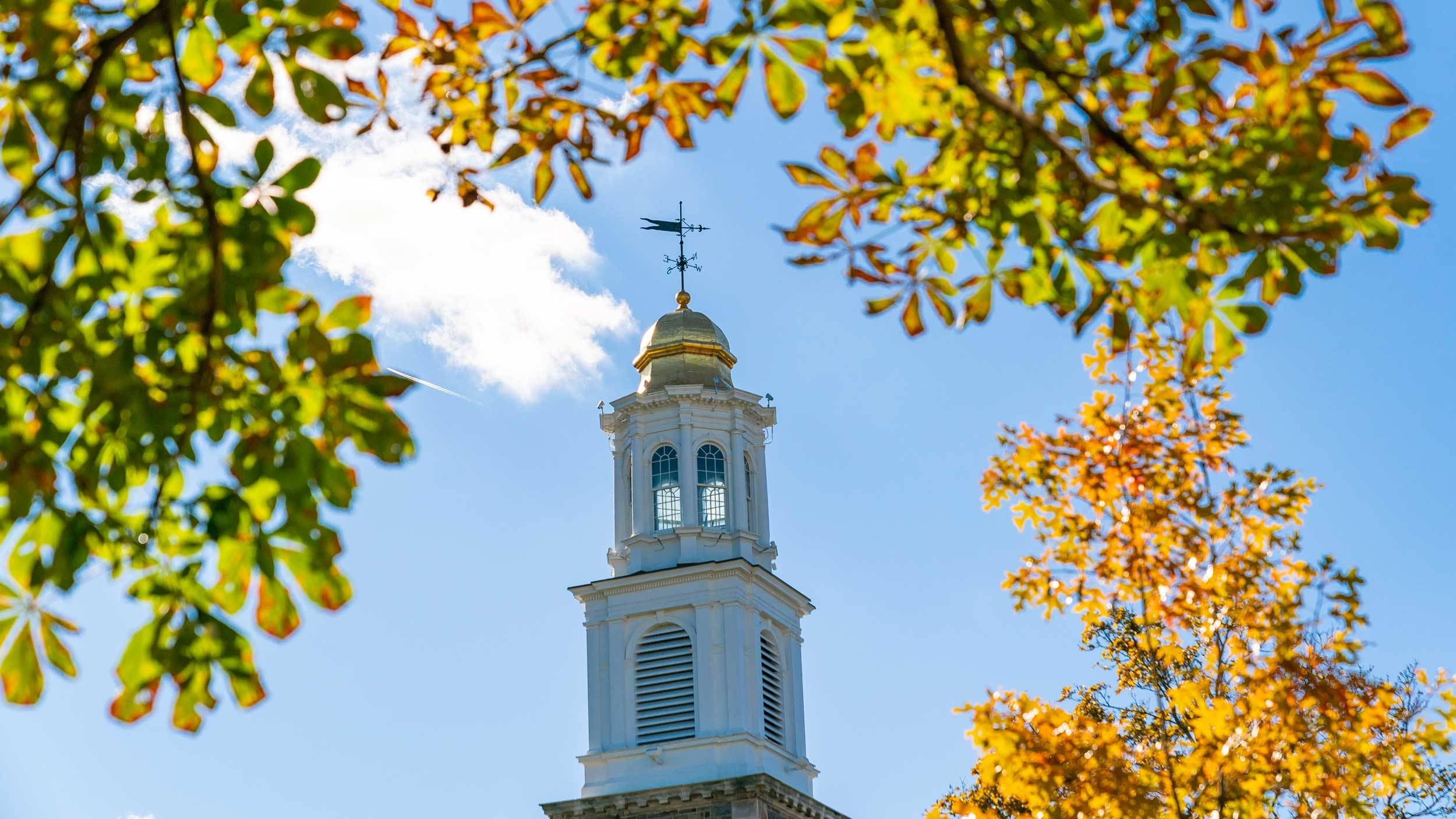 Alumni Memorial Chapel against a blue sky in autumn