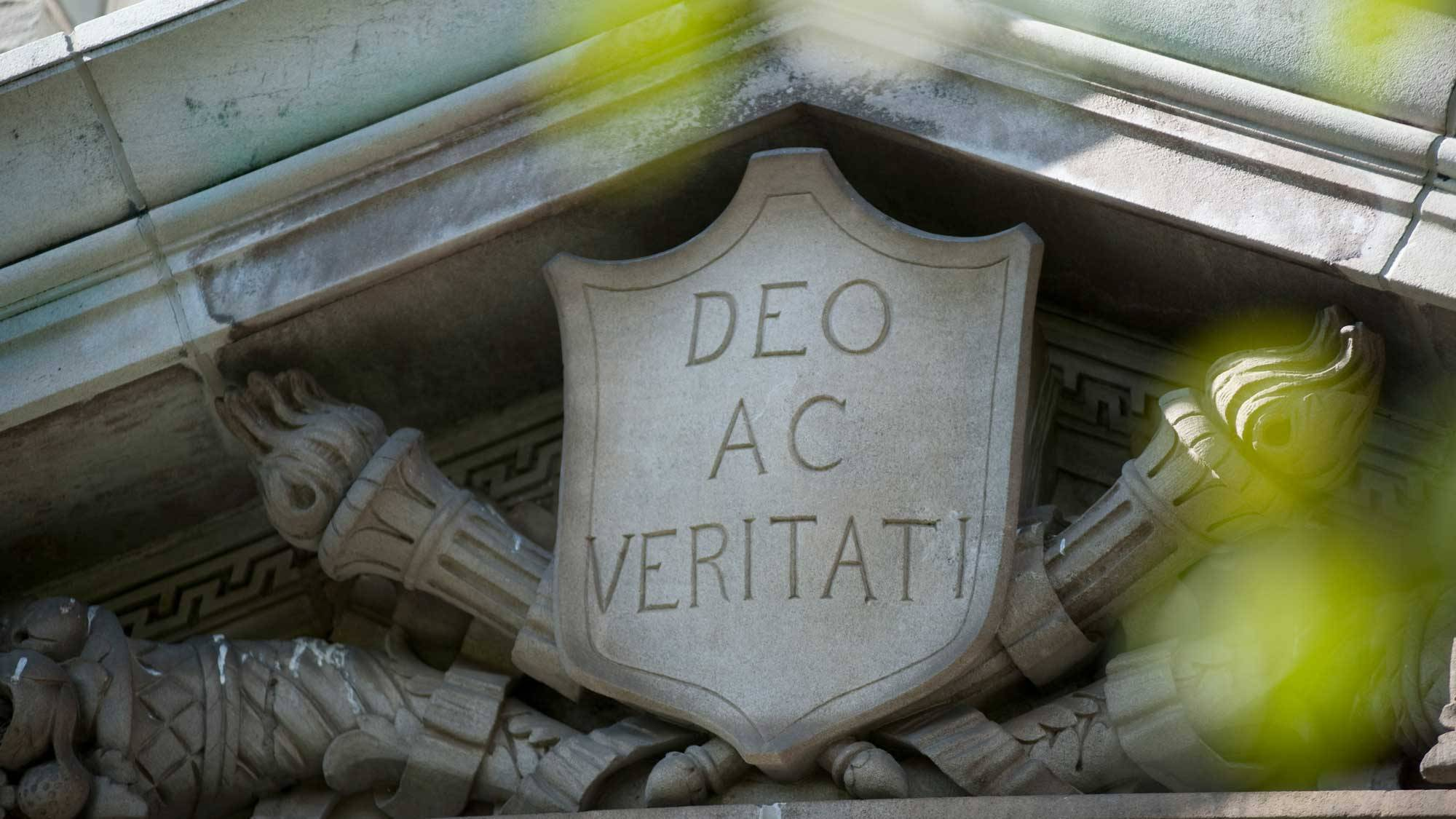 "Image of the Colgate motto, ""Deo Ac Veritati,"" engraved into a stone crest"