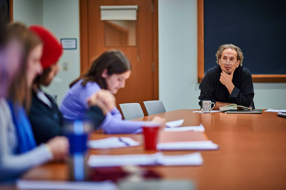 Professor Peter Balakian speaks with one of his classes in 2017.